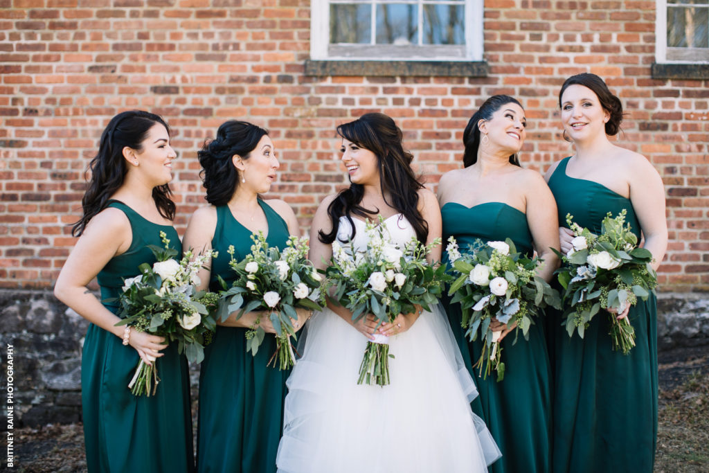 Stephanie and her bridesmaids pose for this sweet photo at a popular photo location close to the wedding venue.