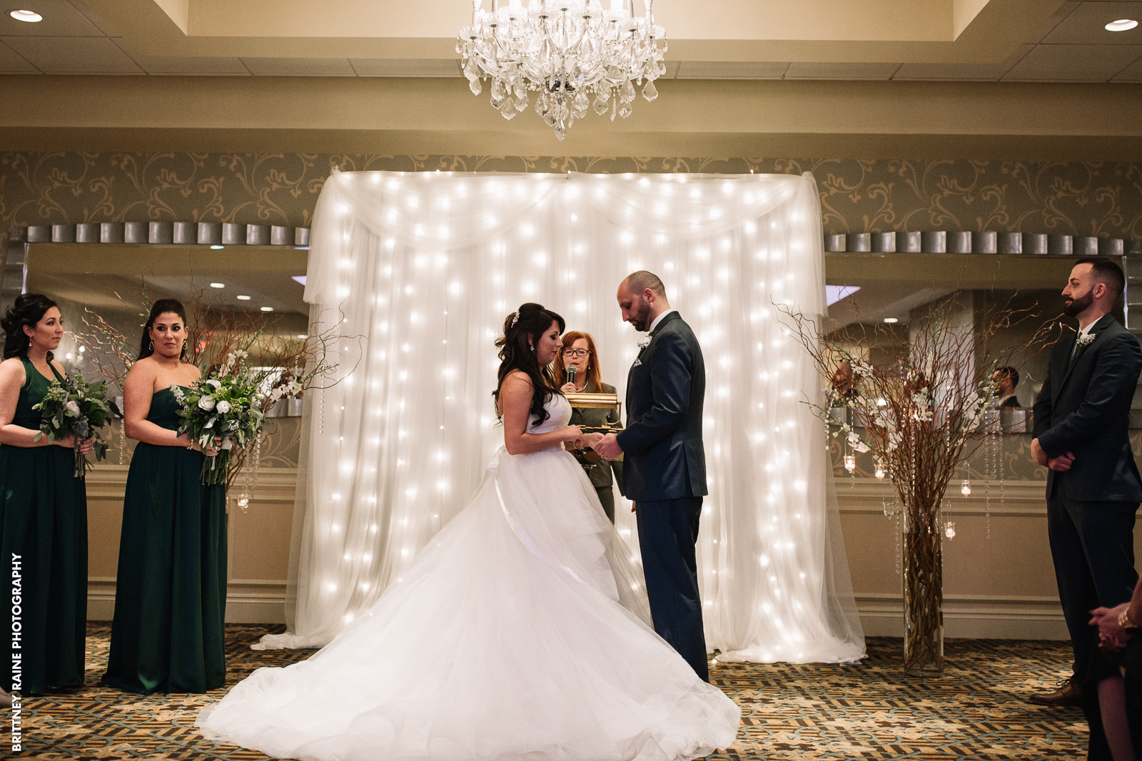 We love the sparkly backdrop Stephanie and Tyler used for their ceremony in the Emerald Ballroom!