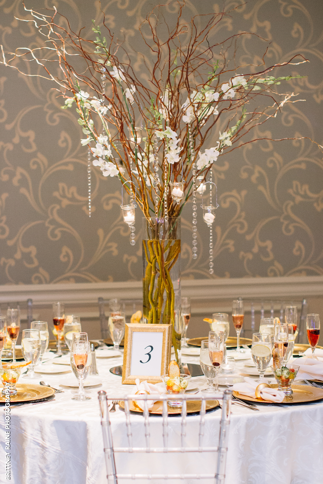 We love these rustic centerpieces the bride and groom brought in for their Emerald Ballroom wedding reception.