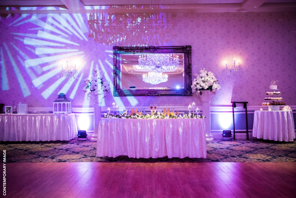 Lovely sweetheart table with some fun DJ lighting